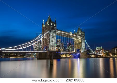 Famous Tower Bridge in the evening with blue sky and reflex on water London England