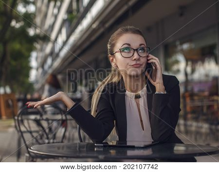 Business woman or teacher talking on the cellphone emotionally distrust skeptic rumor I told you so expression rolling eyes up