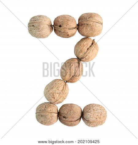 The group of walnuts on white background making letter Z. Studio shot