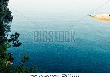Summer view seacoast. Turquoise sea with transparent water and green shore in Ulcinj Montenegro.