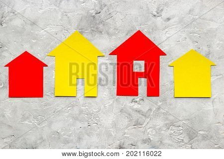 purchasing house set with paper figure on work desk stone background top view mock up