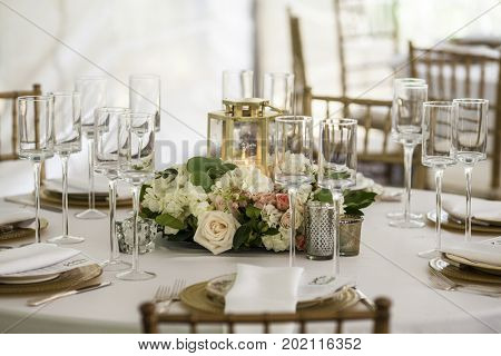 Table set up for wedding reception in tent
