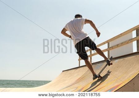 guy skateboarder rides on a ramp on a sunny day