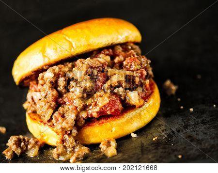 close up of rustic american sloppy joe burger