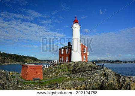 Victoria BC,Canada,January 29th 2015.The Fisgard lighthouse at Fort Rodd Hill National Historic Park in Victoria BC.Come to the park and relax and enjoy the awesome scenery or go inside the lighthouse and see how the keeper lived a century ago.