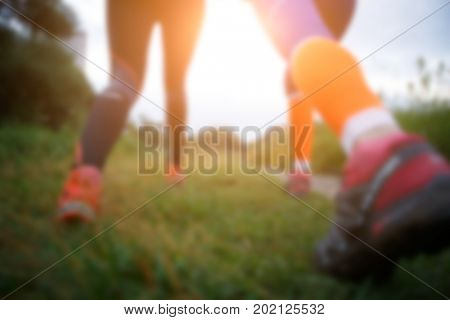 Blurred photo of running women