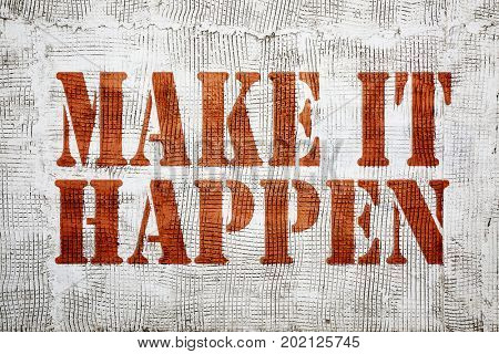 Make it happen - graffiti sign on a stucco wall