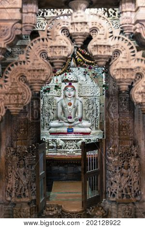 Vertical picture of Jain God inside the Jain Temples located in the Golden City of Jaisalmer in India.