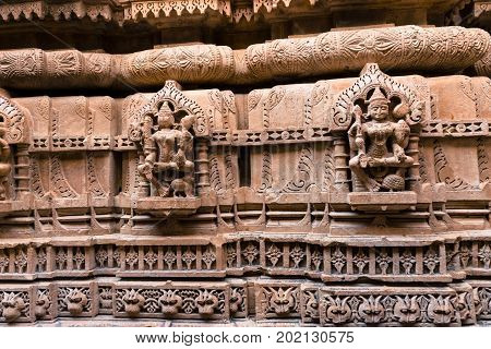 Wide angle front picture of beautiful marble stone carving on the wall of Jain Temples inside the fort of Jaisalmer in India.