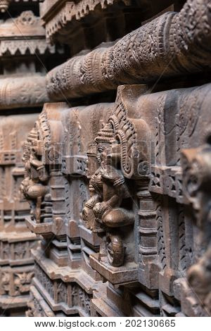 Vertical picture of amazing marble stone carving on the wall of Jain Temples inside the fort of Jaisalmer in India.
