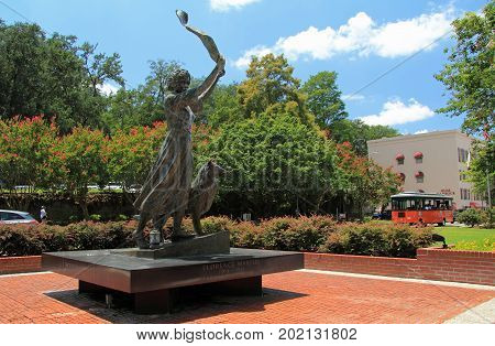 SAVANNAH, GA - JULY 22: A tribute to Florence Martus, the Waving Girl statue stands watch over the Savannah River July 22, 2017 in Savannah, GA
