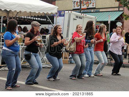 Denver, Colorado - September 17, 2011: Girls having fun at Oktoberfest in downtown Denver