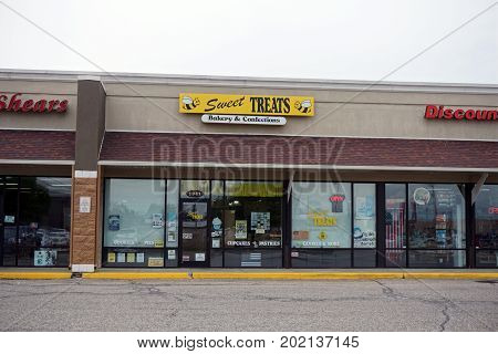 CADILLAC, MICHIGAN / UNITED STATES - JUNE 22, 2017: One may purchase bakery goods and confections at Sweet Treats, in the Village at Wexford shopping center.