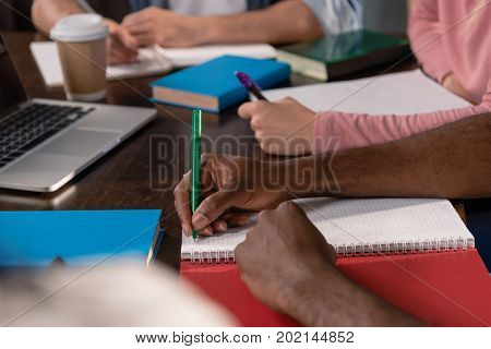 Students Writing In Copybooks
