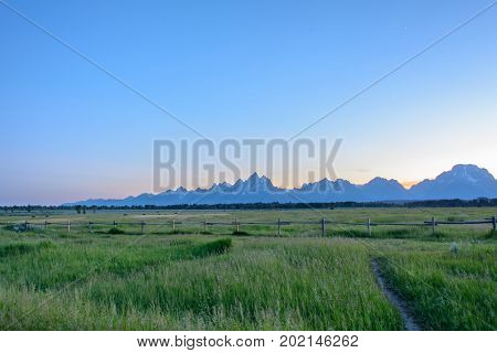 Rocky Mountains of Grand Teton on a sunset background in the Wyoming state, USA