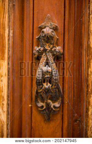 Rusty Vintage Door Handle On A Wooden Door