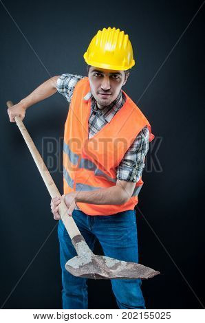 Constructor Wearing Equipment Holding Hoe Like Digging