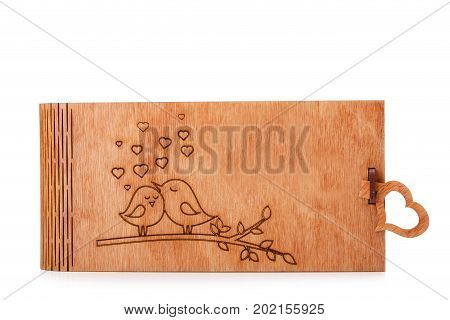 A cute, beautiful little wooden box with a lovely scorched picture isolated on a white background. A vintage, light brown wooden container for keeping toys, books or kids storage. Copy space.