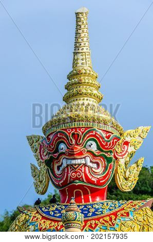 Close up head of big red giant that is the guardian of the northern direction in Thailand.