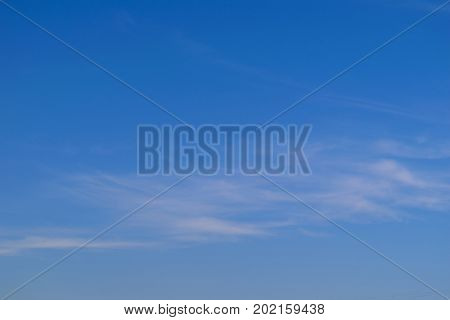 Background of blue sky and white cirrus clouds.