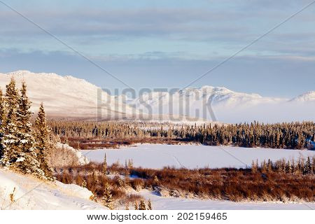 Scenic Winter At Frozen Lake Laberge Yukon Canada