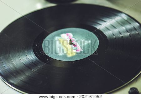 Closeup of vinyl disc turntable player