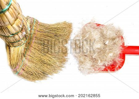 Cleaning wool hair of pet with broom and shovel close-up isolated on white background. Broom, shovel, ball of wool, garbage cleaning