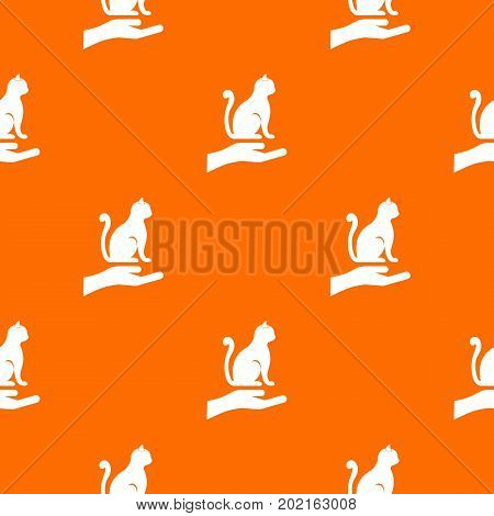 Hand holding a cat pattern repeat seamless in orange color for any design. Vector geometric illustration