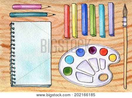 watercolor artistic workspace, hand drawn mock up, sketchbook, pastel crayons and pencils at wood table, painting illustration