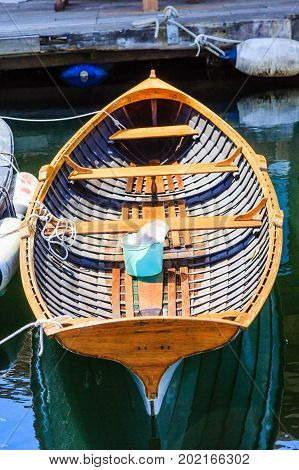 Blue Bucket in Wood Boat at Dock