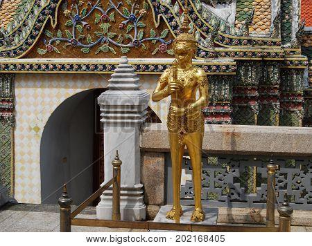 Bangkok, Thailand. The Grand Palace. Golden watcher statue.