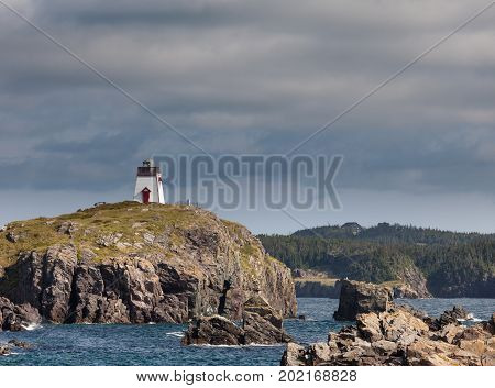 Trinity Harbour Lighthouse on rocky Fort Admirals Point on Bonavista Peninsula Newfoundland NL Canada