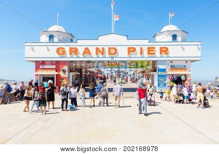 Weston-super-Mare United Kingdom - June 17 2017: People are visiting the Pier in Weston-super-Mare on a sunny day out.