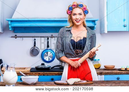 Housewife With Dough And Rolling Pin