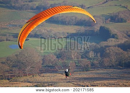 Tandem paraglider flying in the Brecon Beacons