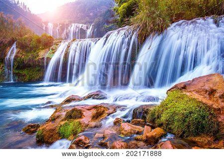 Jiulong waterfall in Luoping China, famous waterfall.