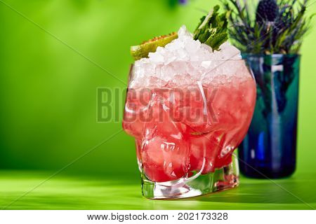 Halloween Cocktail - Zombie Cocktail on Bright Green Background