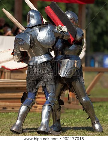 ST. PETERSBURG, RUSSIA - JULY 9, 2017: Armored knight fighting in the tournament during the military history project Battle On Neva at St. Peter and Paul fortress. It's the 4th such an event