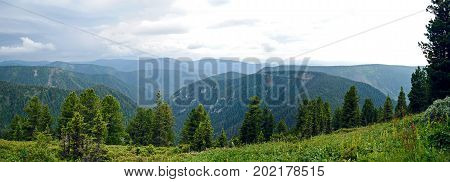Panorama of rocky coast and mountains near Lake Baikal.