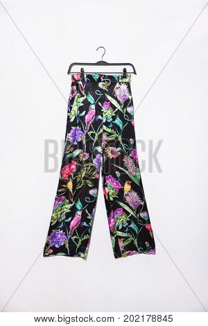 floral trousers,pants on hanging isolated