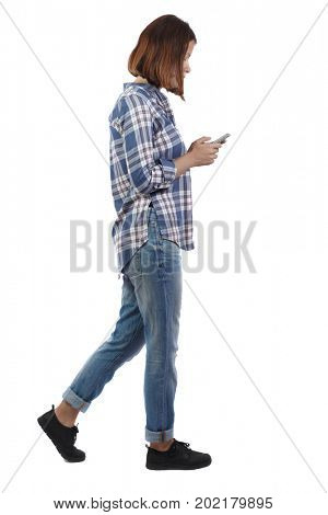 back view of woman walking with a mobile phone. back view of woman in motion.  backside view of person. Rear view collection. Isolated over white background. girl in a plaid shirt shows sign of party