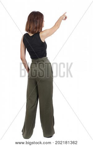 Back view of  pointing woman. beautiful girl. Rear view people collection.  backside view of person.  Isolated over white background. A top view of a girl in green stands rubbing her head thoughtfully