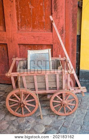 Old hand truck and washboard in front of an antiques shop in Rudkobing, Langeland, Denmark