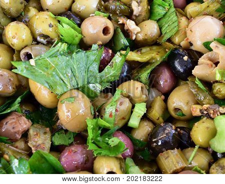 olives mix close up, many olives, green olive marinade, different coloured olives, olives and herbes, celery stalks