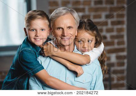 Happy Grandfather And Grandchildren