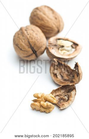 Cracked dried walnuts isolated on white background. Tasty nuts.