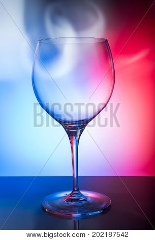 Glass of wine on a colored background