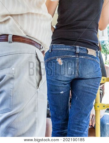 Passenger Bus In Jeans With A Hole In The Ass, Made Deliberately To Attract The Attention Of Men.