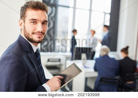 Man as business consultant with tablet computer planning strategy