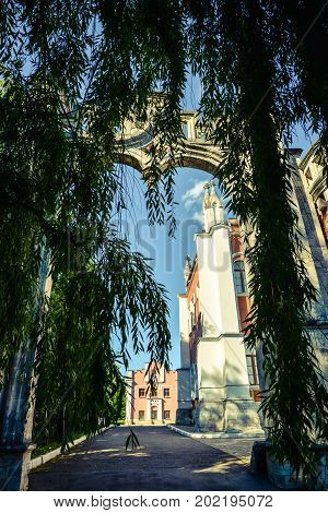 View on Marfino palace in Moscow region and public park. Antique mansion 18th century in Baroque style. Summer landscape with arch and willow for posters, prints,design.